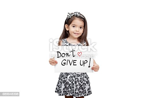 istock Giving encouragement concept, Cute girl holding a dont give up sign standing on white background. Cute mixed race girl half Thai, half English model 3 years old. 689948398