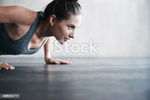 Shot of an attractive young woman working out at the gymhttp://195.154.178.81/DATA/i_collage/pi/shoots/783431.jpg