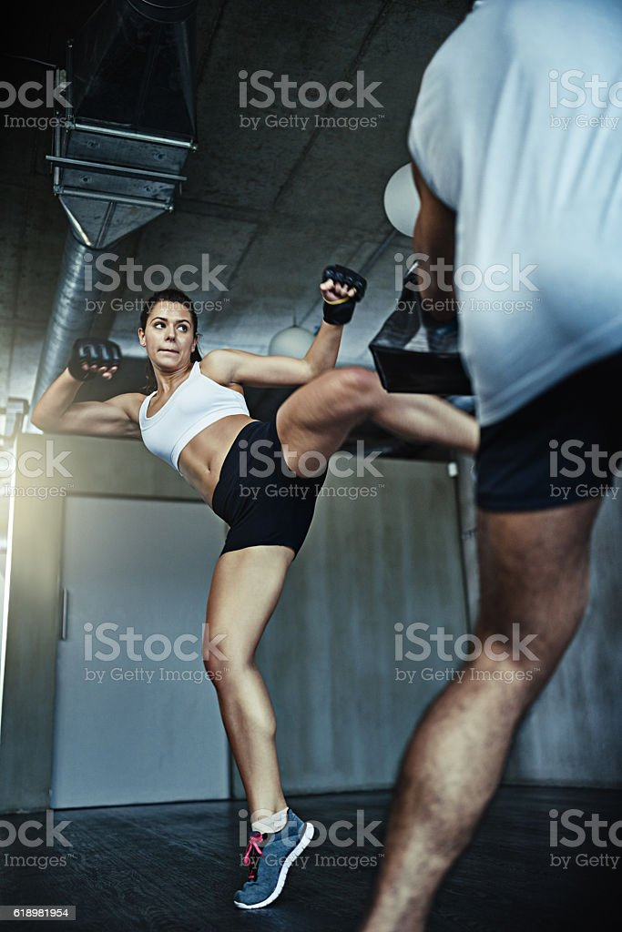 "Giving ""fight like a girl"" a whole new meaning stock photo"