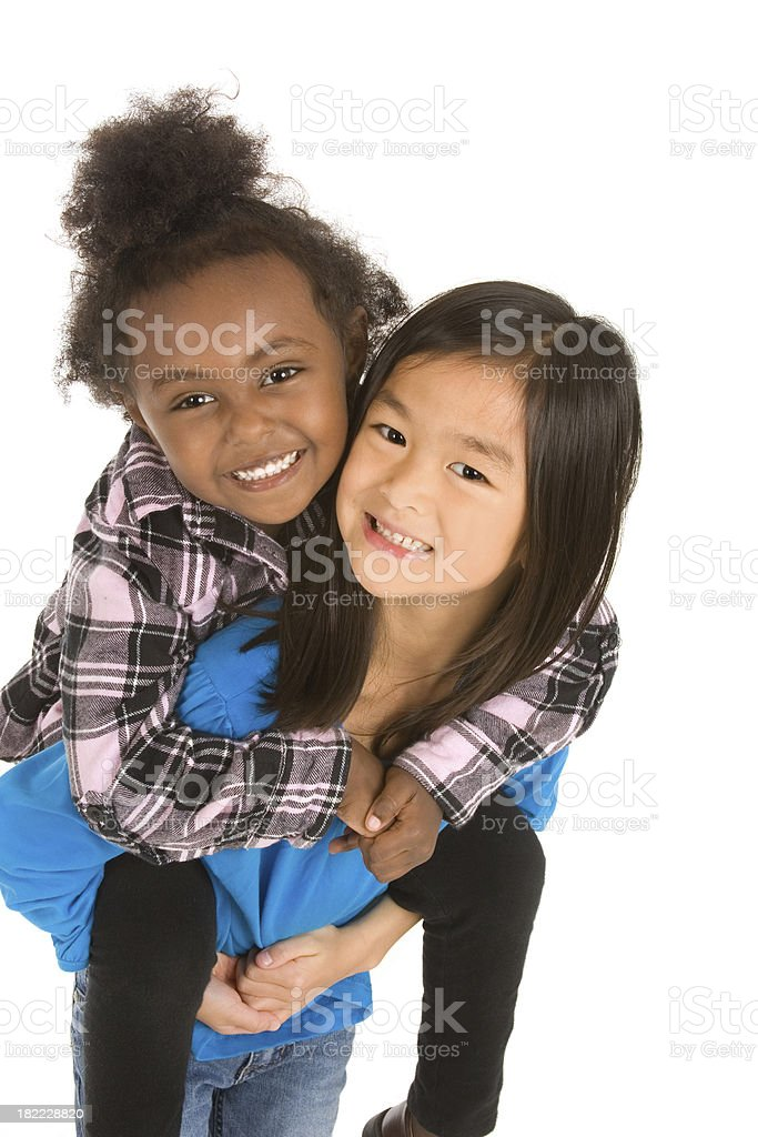 Giving friend a piggyback ride royalty-free stock photo