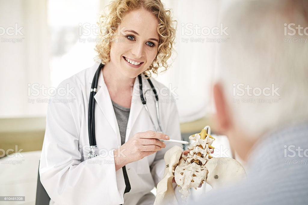 Giving her patient a hands on diagnosis stock photo