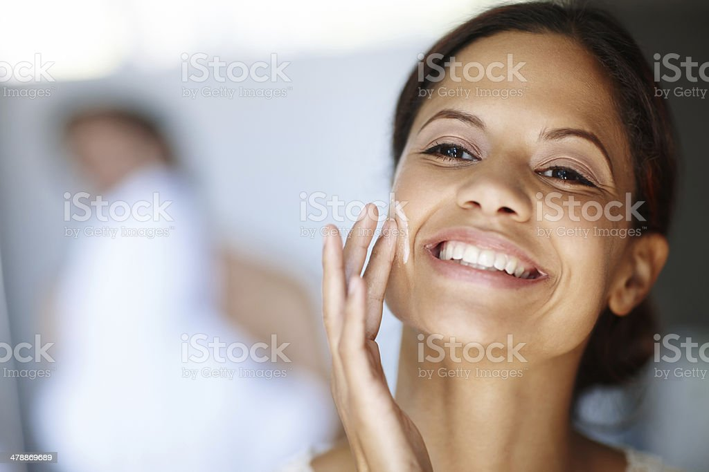 Giving her skin all it needs royalty-free stock photo