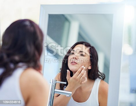 1155167023istockphoto Giving her skin the once over 1094334816