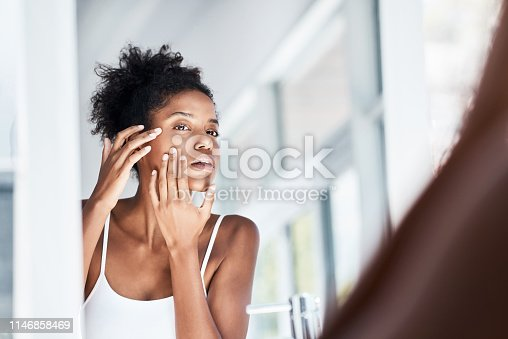 1155167023istockphoto Giving her skin the once over 1146858469