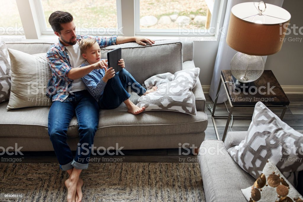 Giving his son a browse through the digital world - Royalty-free Adult Stock Photo