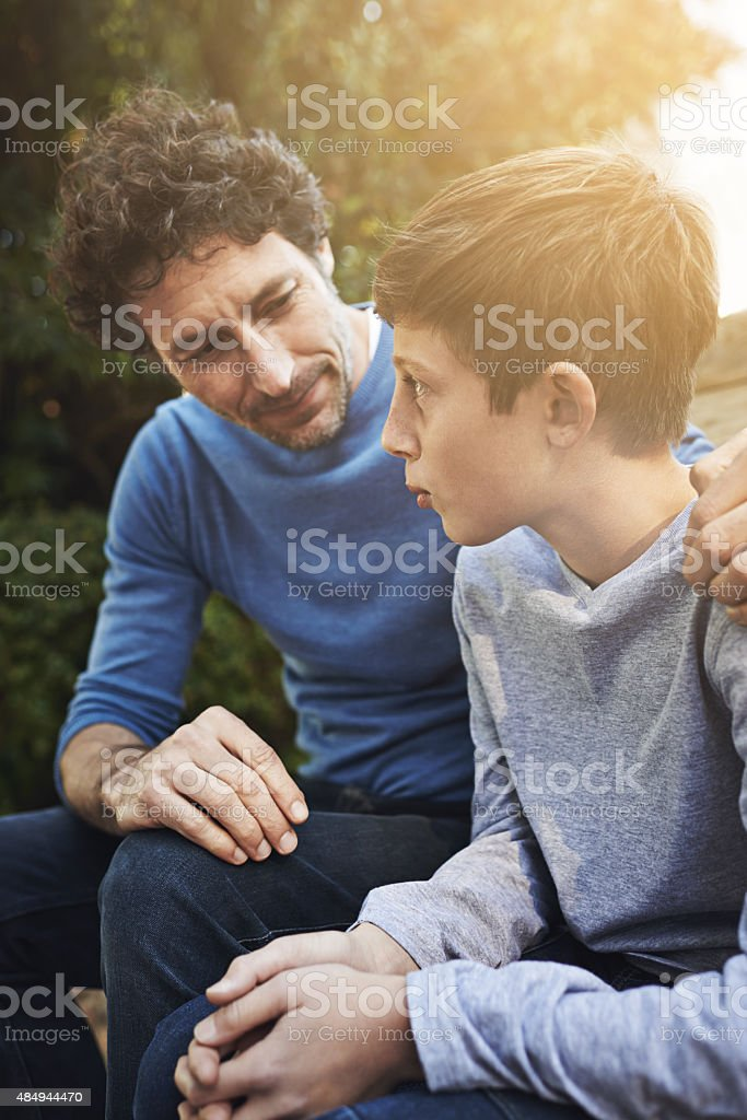Giving his son some fatherly advice royalty-free stock photo