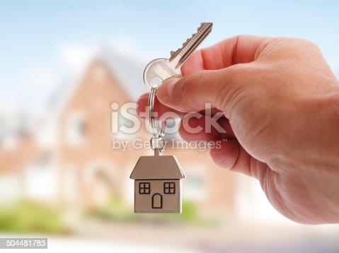 istock Giving house keys 504481783