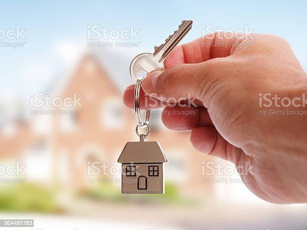 Giving House Keys Stock Photo - Download Image Now