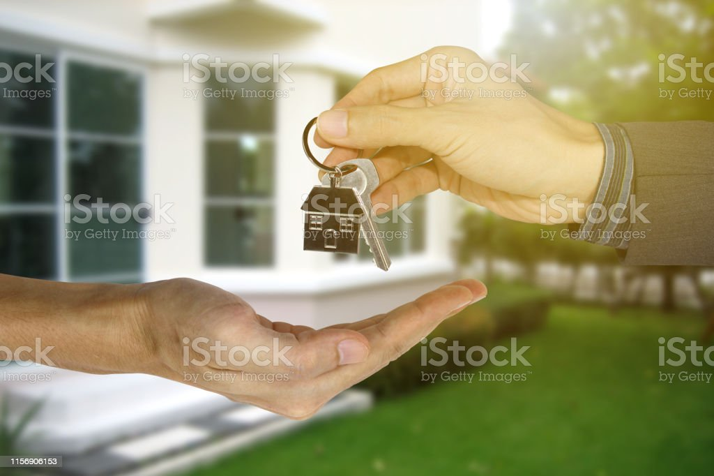 Giving house keys to customers, Property concept, Mortgage and agent...