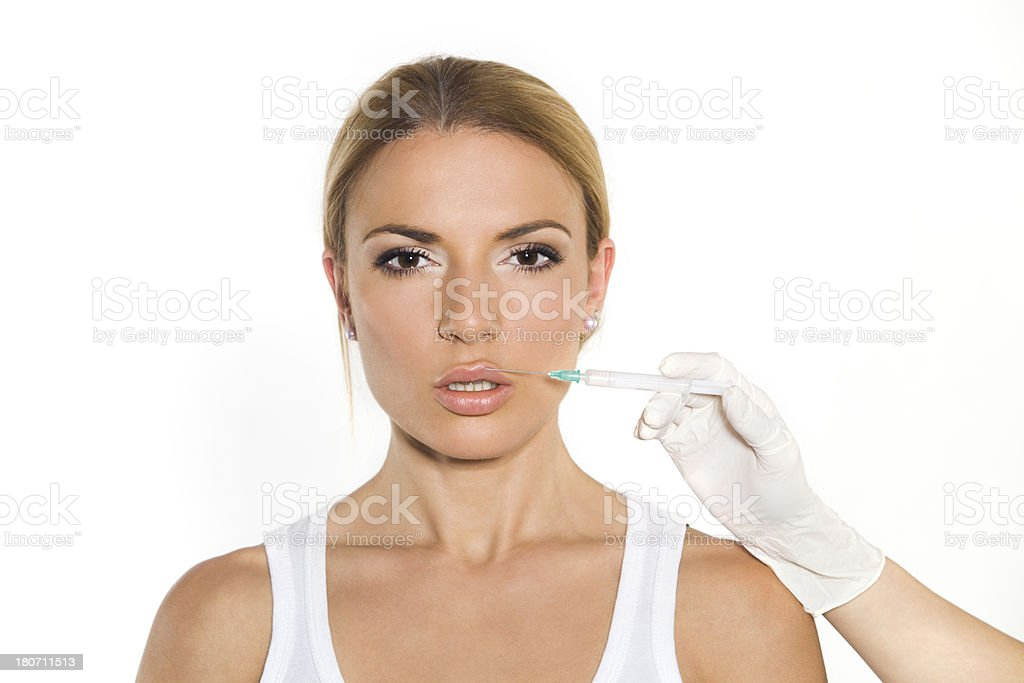 giving injection of botox stock photo