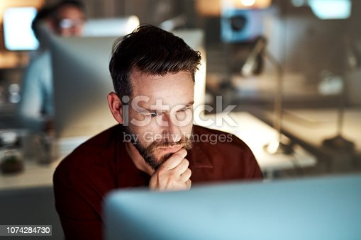 Cropped shot of a handsome young businessman looking thoughtful while working at his desk in the office
