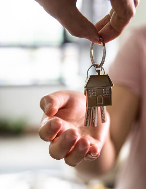 Giving keys to new house owner stock photo