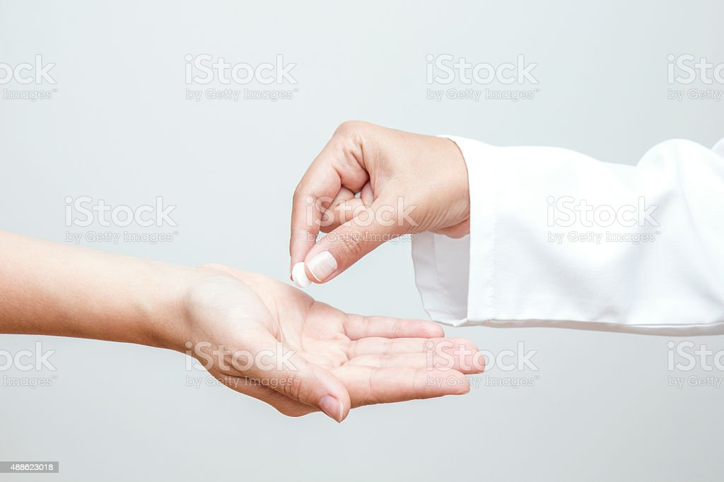 Giving Medicine to Patient stock photo