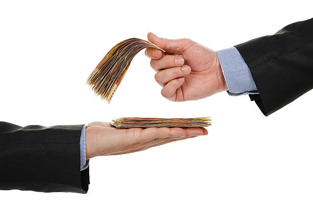 giving or taking money male hand giving money to another one, isolated on white borrowing stock pictures, royalty-free photos & images