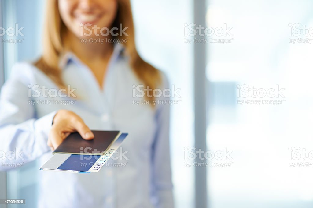 Giving passport with tickets stock photo