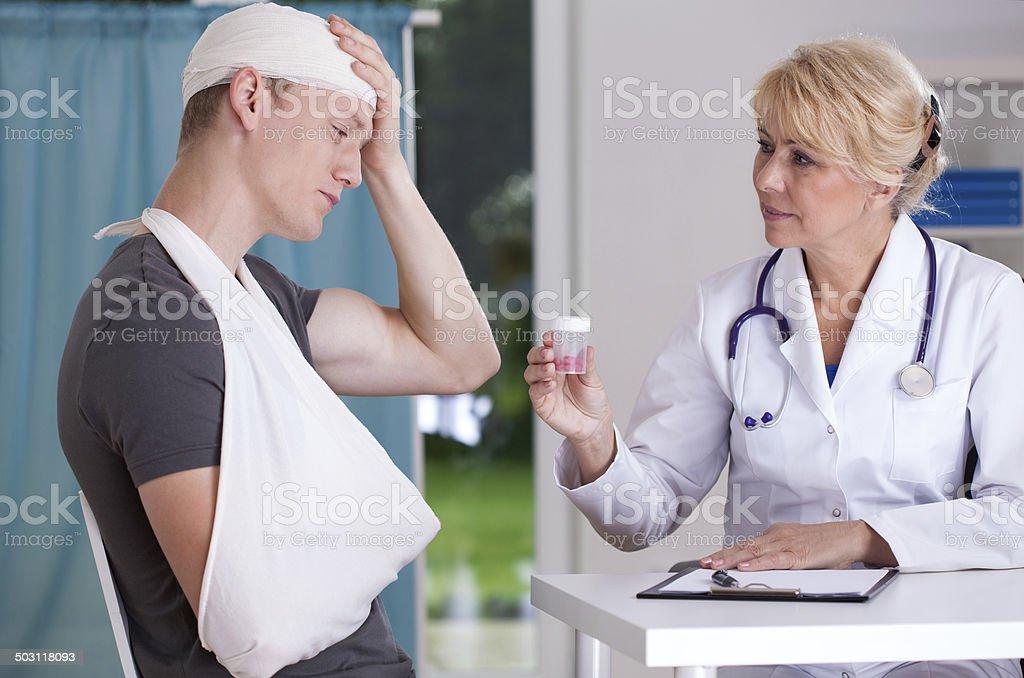 Giving pills for headache stock photo