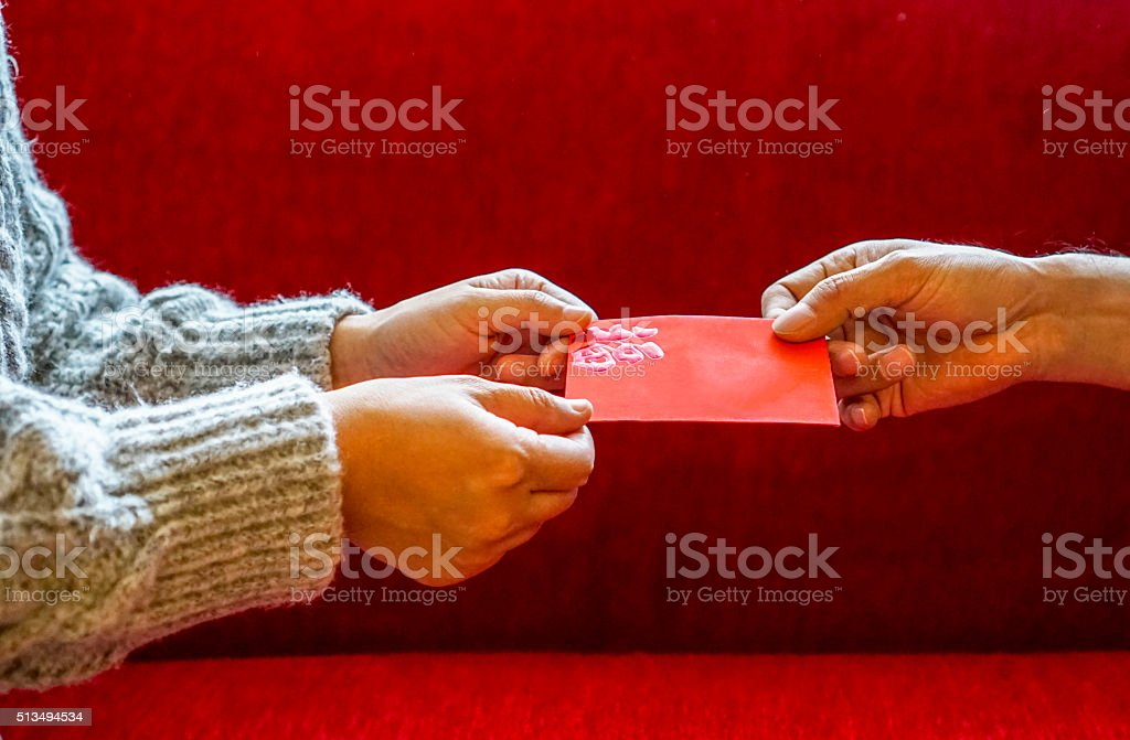 giving red envelope on holiday stock photo