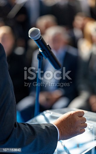 854811490 istock photo Giving speech at conference 1071153840