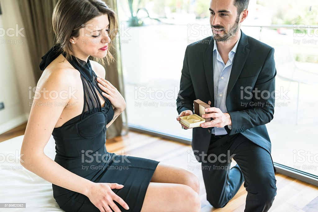 Giving the engagement ring stock photo