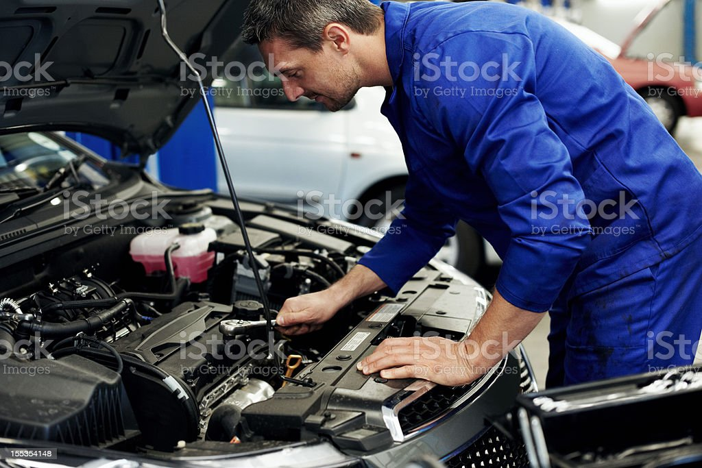 Giving the engine back it's spark ... plug! royalty-free stock photo