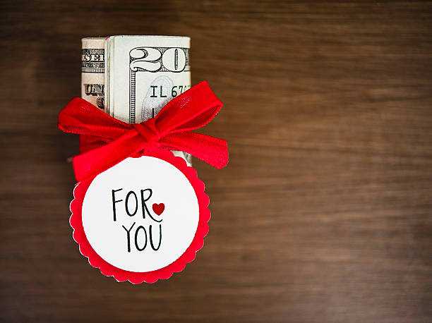 giving the gift of cash at christmas - gift tag note stock photos and pictures