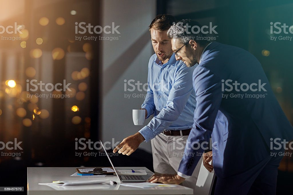 Giving the project all of their attention stock photo