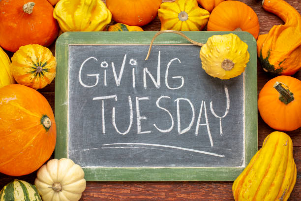 Giving Tuesday blackboard sign stock photo
