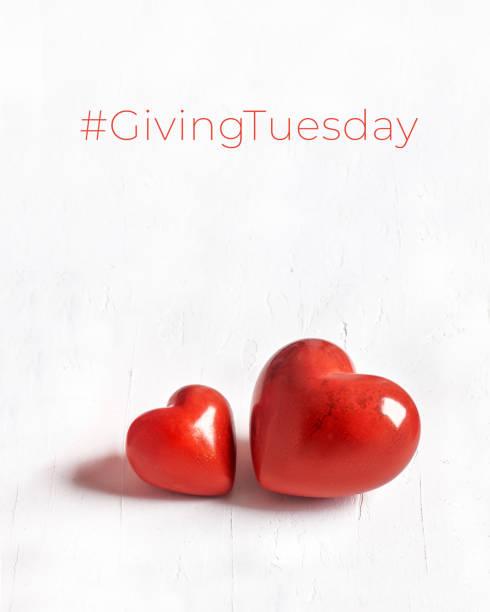 давать вторник, глобальный день благотворительности. черная пятница благотворительности, глобальный благотворительный лагерь. два каменн - giving tuesday стоковые фото и изображения