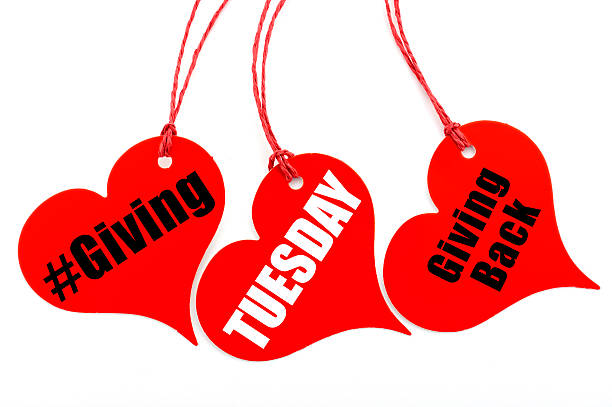 Giving Tuesday heart shape ticket. stock photo