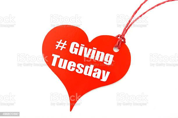 Giving Tuesday red heart shape ticket, with sample text on white background.