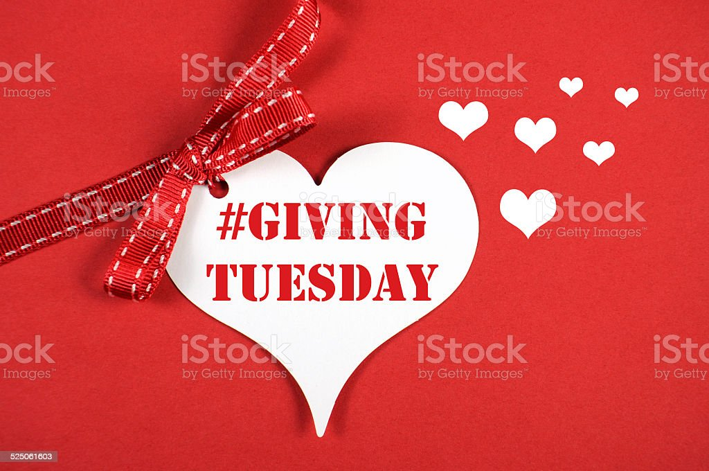 Giving Tuesday heart sign stock photo