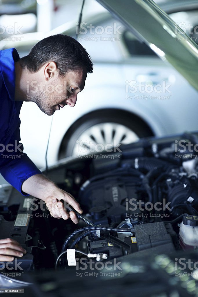 Giving your car a full service royalty-free stock photo