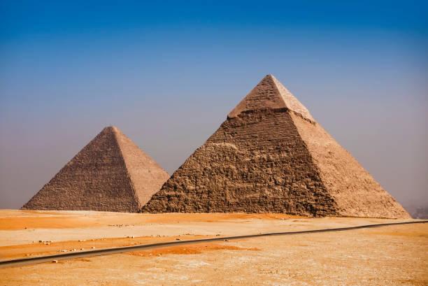 giza pyramids, cairo, egypt - pyramid stock photos and pictures