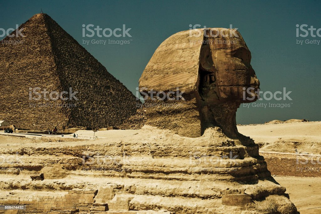 Giza Sphinx profile view with background of the Sahara desert stock photo
