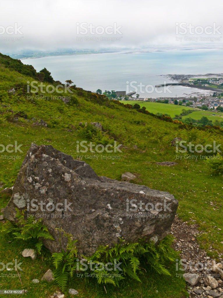 Glacial Erratic Overlooking Bay stock photo