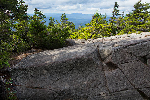 Glacial groove in granite bedrock, Mt. Kearsarge, New Hampshire. stock photo