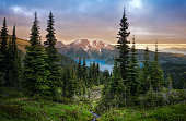 istock Glacial mountain Garibaldi lake with turquoise water in the middle of coniferous forest at sunset. 1244372877