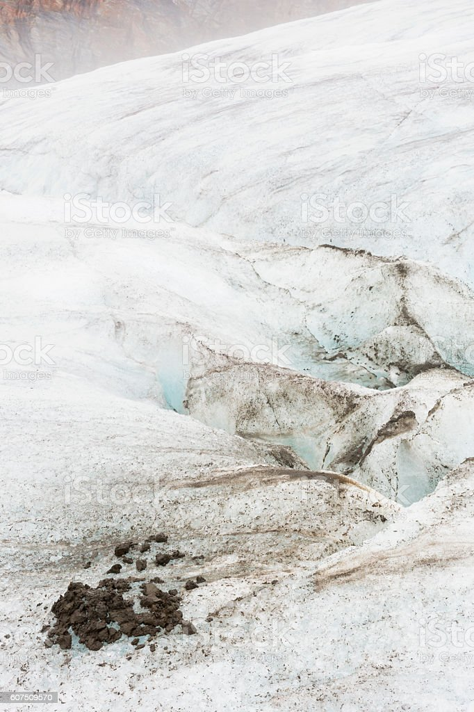 Glacial silt sediment piled up on ice stock photo