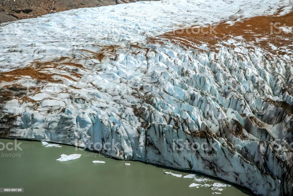Glaciar at the foot of Cerro Torre stock photo
