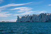 Glacier and artic sea at Svalbard Islands with sun