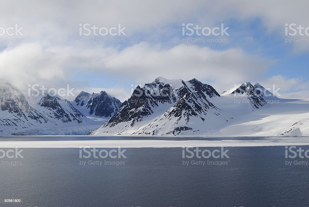 Glacier and mountains in Spitsbergen royalty-free stock photo
