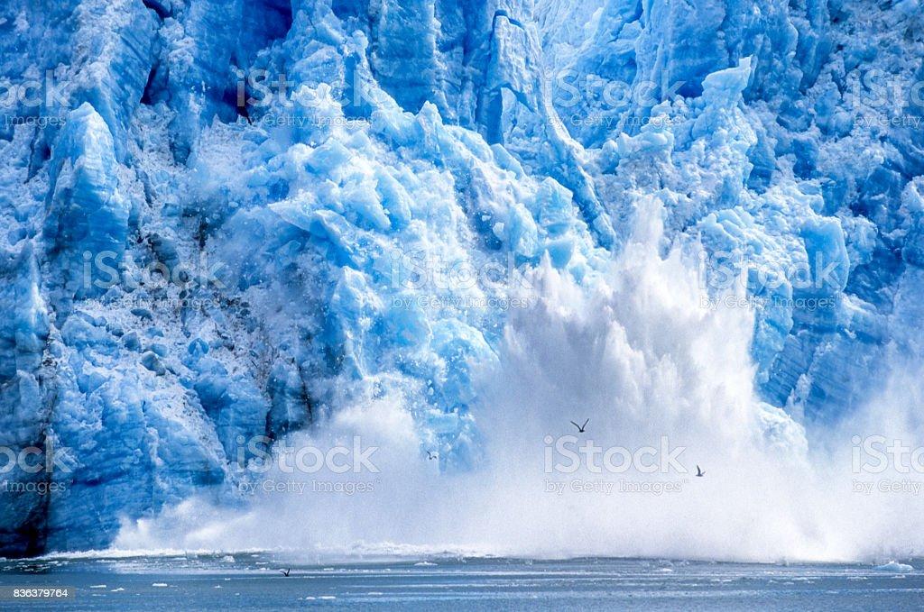 Glacier Calving into Alaskan Bay stock photo