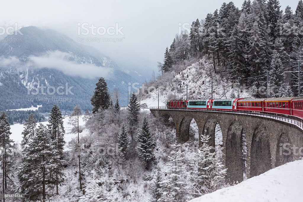 Glacier express, Switzerland Famous sightseeing train running over viaduct in Switzerland, the Glacier Express in winter Cultures Stock Photo