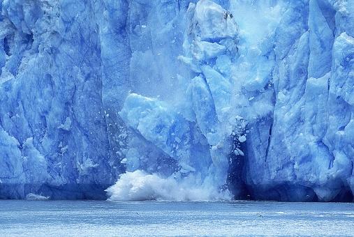 Glacier in Alaska, Piece of Ice falling into Ocean, Symbol for the lobal Warming