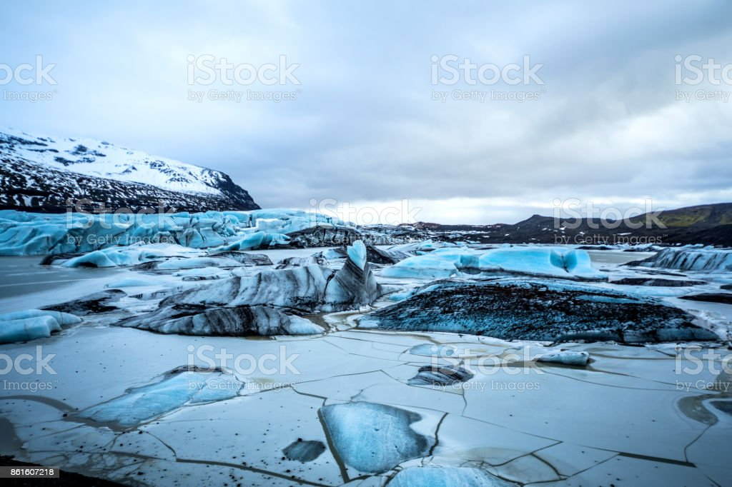 Glacier in Iceland - Blue icebergs floating in the lagoon – zdjęcie