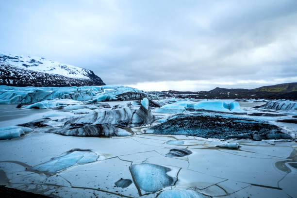 Glacier in Iceland - Blue icebergs floating in the lagoon Glacier in Iceland - Blue icebergs floating in the lagoon glacier lagoon stock pictures, royalty-free photos & images