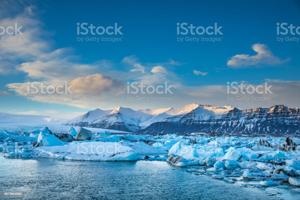 Glacier in Iceland - Blue icebergs floating in the lagoon stock photo