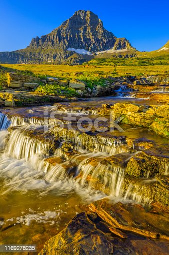 Reynolds creek waterfalls and Mount Reynolds at Logan Pass in Glacier National Park in Montana USA