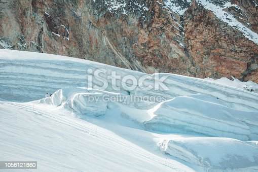 Scenic view of glacier against mountain wall in Switzerland.