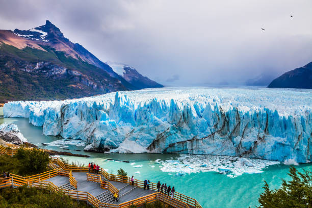 Glacier Perito Moreno in the Patagonia Grandiose glacier Perito Moreno in the Argentine part of Patagonia. The concept of ecological and extreme tourism. Large and comfortable observation deck for tourists Argentina stock pictures, royalty-free photos & images